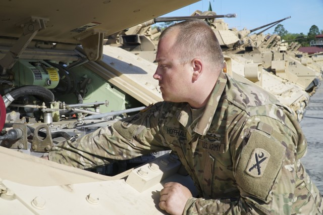 U.S. Army Staff Sgt. Jeffrey Hoffhaus, Company A, 4-118th Combined Arms Battalion, 218th Maneuver Enhancement Brigade, South Carolina National Guard, inspects his M2 Bradley Infantry Fighting Vehicle prior to a sectional-level gunnery exercise at Fort Stewart, Georgia, April 10, 2017.