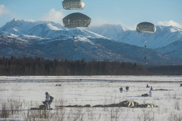 Note: Early entry photo for illustration purposes only; Transportable Tactical Command Communications (T2C2) was not used during this event. Paratroopers with 4th Infantry Brigade Combat Team (Airborne), 25th Infantry Division recover gear and land on Malemute drop zone at Joint Base Elmendorf-Richardson, Alaska, Feb. 15, 2017.  Once fielded, the Army will use Transportable Tactical Command Communications (T2C2) during the early entry missions to provide continuity of mission command during the initial phases of operation.  (U.S. Army photo by Staff Sgt. Daniel Love)