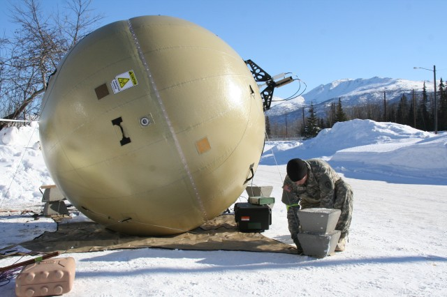 A Soldier from the 4th Infantry Brigade Combat Team (Airborne), 25th Infantry Division, U.S. Army Alaska sets up a Warfighter Information Network-Tactical (WIN-T) Transportable Tactical Command Communications (T2C2) Heavy satellite terminal in March 2017 during the pilot phase of the T2C2 operational test. (U.S. Army photo by Amy Walker, PEO C3T Public Affairs)