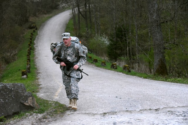 Sgt. 1st Class Russell Merrill, Company C, 53rd Signal Battalion, participates in the 12-mile ruck march April 13 as one of the Best Warrior Competition European region events. Merrill took the Best Noncommissioned Officer honors of the competition that took place in Baumholder, Germany, April 10-13.