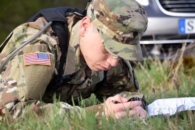 Spc. Eduardo Herrera, Company C, 53rd Signal Battalion, participates in the day land navigation April 13 as one of the Best Warrior Competition European region events. Herrera took the Best Soldier honors of the competition that took place in Baumholder, Germany, April 10-13.