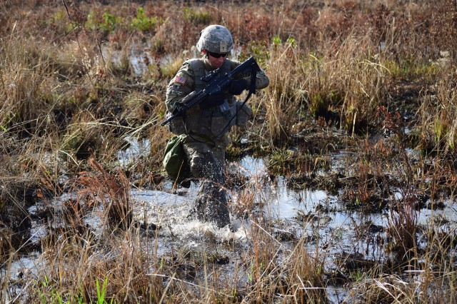 A combat engineer assigned to the 10th Engineer Battalion maneuvers through a marsh as his team prepares to breach an obstacle during their Gunnery Table XII engagement in December 2016 at Fort Stewart, Georgia. The Army has not developed a new jungle boot since the Vietnam War era. (Photo by Spc. Ryan Tatum, 1st Armor Brigade Combat Team, 3rd Infantry Division)