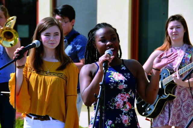 (From left to right) Nicole McCollaum, Tonae Walker and Serena Bradford, members of the Vicenza High School Rhythm and Blues Band, perform at the event, which also included a variety of fun activities for children.