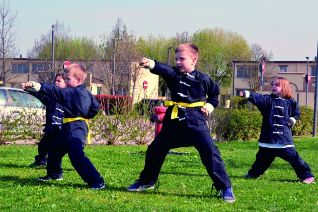 Children from SKIES Unlimited kung fu, under direction of Simone Marini (not pictured), participate in the MOMC kickoff event on Villaggio. To see more photos, visit the USAG Italy Flickr page, https://www.flickr.com/photos/usagvicenza/albums/72157680484828861.
