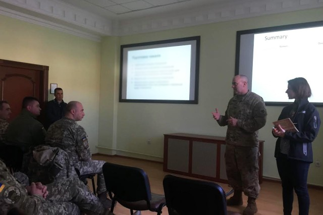 Col. David Jordan, commander of the 45th Infantry Brigade Combat Team and Joint Multinational Training Group-Ukraine, debriefs a group of Ukrainian soldiers during an after action review in conjunction with the brigade-level computer simulated exercise, Cossack Hetman, at the Combat Training Center near Yavoriv, Ukraine on April 8, 2017.