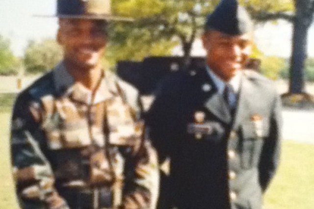 Drill Sergeant Ulysses D. Rayford poses with a trainee at Fort Gordon, Ga. Rayford served as a drill sergeant from 2001 to 2004, during which time he was named the 2003 Fort Gordon Drill Sergeant of the Year.