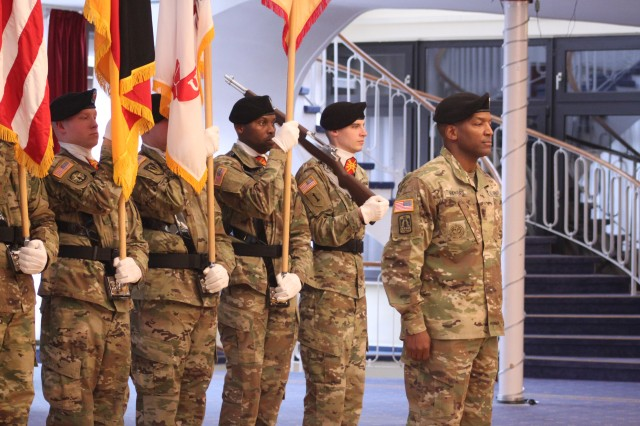 U.S. Army Garrison Rheinland-Pfalz Command Sgt. Maj. Ulysses D. Rayford stands with the color guard at the garrison change of responsibility ceremony at Armstrong's Club on Vogelweh, Dec. 16, 2016. Rayford, who serves as the garrison's highest enlisted non-commissioned officer spent his first 100 days of leadership listening to Soldiers and family members and prioritizing the important tasks that needed attention.