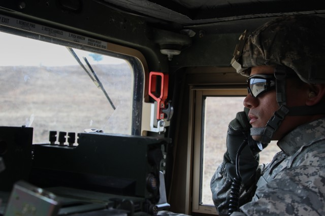 US Army 1st Lt. Edward Manibusan, a human resources officer with the 364th Civil Affairs Brigade, 351st Civil Affairs Command, communicates with the range tower during a firing exercise as part of Operation Cold Steel at Fort McCoy, Wis., on April 02, 2017.
