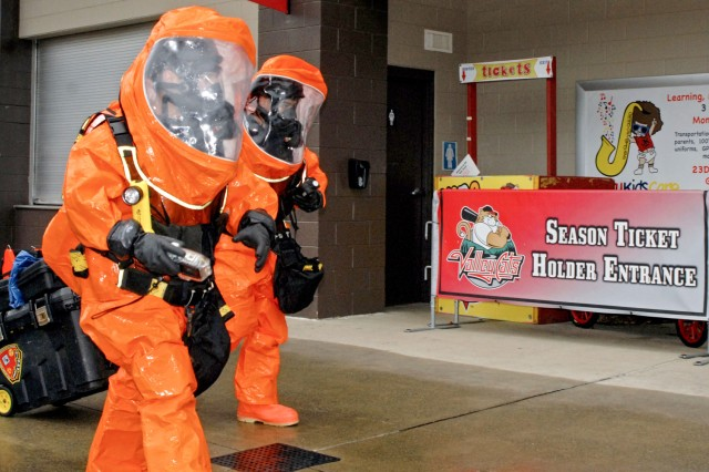 Clad in hazmat suits, 2nd Civil Support Team (CST) members Staff Sgt. Joshua Spagnola (left) and Sgt. Christopher Rodriguez (right) search for a mock WMD laboratory during the 2nd CST's training exercise at Joseph L. Bruno Stadium in Troy, N.Y. on April 12, 2017. Team members are trained to identify chemical, biological, and radiological agents and advise first-responders on how to deal with these materials.