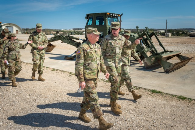 Lt. Gen. Kenneth Dahl, commander of the U.S. Army Installation Management Command, left, tours Training Area 244 with Brig. Gen. James Raymer, U.S. Army Engineer School commandant, April 12 during Dahl's visit to Fort Leonard Wood.