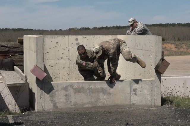 Instructors at the grenade range demonstrate what happens when a Soldier fails to throw the grenade down range over the concrete wall. When this happens, the instructor ensures that the Soldier exits the grenade pit quickly and then gets on top of the Soldier against the short wall to avoid injury from shrapnel.
