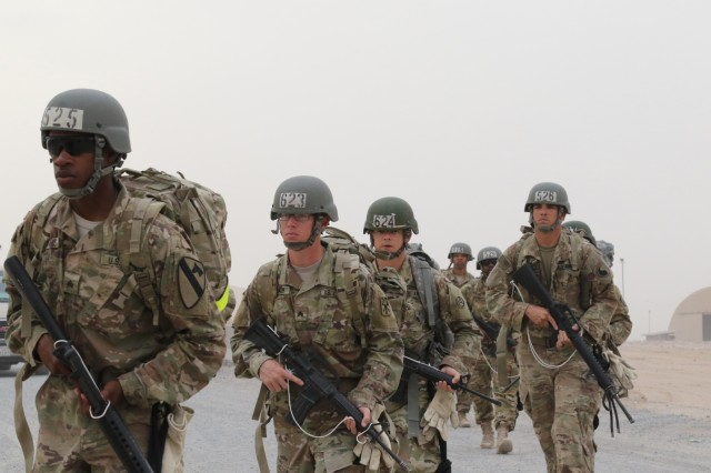 U.S. Servicemembers march toward the day 10 rappel tower at the Air Assault Course, April 12, 2017, at Camp Buehring, Kuwait. The Air Assault Course is a 12-day class that allows U.S. military personnel in the U.S. Army Central area of operations the unique opportunity to become air assault qualified, while deployed outside the continental United States.