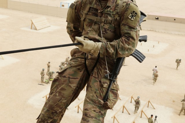 U.S. Army Spc. Caleb Choate, a patriot fire control enhanced operator/maintainer, 108th Air Defense Artillery Brigade, prepares to descend down the rappel tower at U.S. Army Central's first Air Assault Course, April 12, 2017, at Camp Buehring, Kuwait. The Air Assault Course is a 12-day class that allows U.S. military personnel in the U.S. Army Central area of operations the unique opportunity to become air assault qualified, while deployed outside the continental United States.