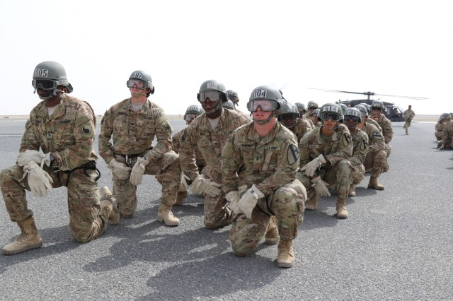 U.S. Servicemembers prepare to rappel out of a UH-60 Black Hawk helicopter during U.S. Army Central's first Air Assault Course, April 13, 2017, at Camp Buehring, Kuwait. The Air Assault Course allows U.S. military personnel in the U.S. Army Central area of operations the unique opportunity to become air assault qualified, while deployed outside the continental United States