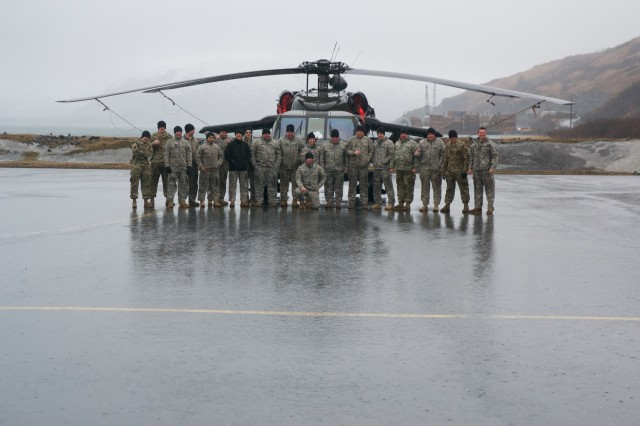 Alaska Army National Guard Aviation Soldiers pose for a photograph in front of a UH-60 Blackhawk helicopter in April. Soldiers from 1st Battalion, 207th Aviation Regiment, and 2-104th General Support Aviation Battalion, were in Kodiak supporting Arctic Care 2017, a multi-service health care training exercise supporting communities in rural Alaska.