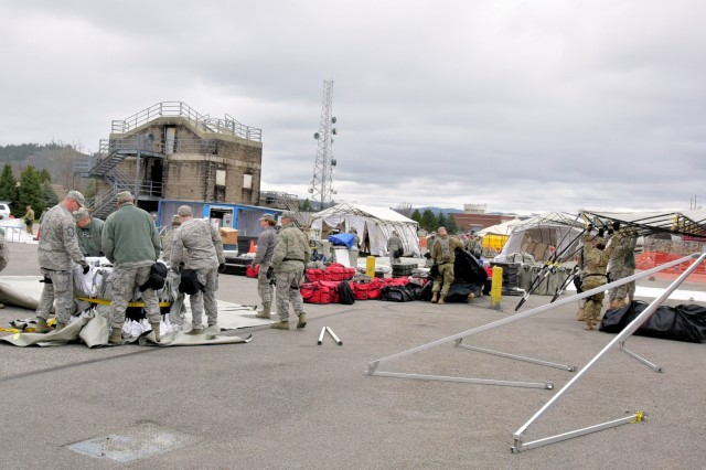 Members of the Washington National Guard's 10th Homeland Response Force (HRF) set up for training at the Spokane Readiness Center Apr. 7-9, 2017.  More than 330 members of the HRF trained to mobilize and deploy in support of the Federal Emergency Management Agency to assist first responders in evacuating casualties, providing decontamination and medical triage during a CBRNE incident. (U.S. Army National Guard photo by Maj. Matt Baldwin)