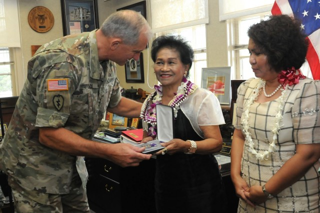 Gen. Robert B. Brown (left), Commanding General, U.S. Army Pacific, presents a replacement Purple Heart medal to Elisea Alagon Jamoralin (center), whose father Pfc. Adriano Alagon died while serving with the Philippine Scouts during the Japanese occupation of the Philippines. Looking on is Philippine Consul General in Honolulu Gina A. Jamoralin, the granddaughter of Pfc. Alagon.  (U.S. Army photo by Staff Sgt. Christopher McCullough)