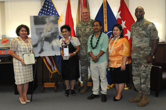 Gen. Robert B. Brown (center), Commanding General, U.S. Army Pacific, and USARPAC Command Sgt. Maj. Bryant Lambert (right), pose for a picture with Elisea Alagon Jamoralin (second from left), whose father Pfc. Adriano Alagon died while serving with the Philippine Scouts during the Japanese occupation of the Philippines. Brown presented Jamoralin with a replacement Purple Heart medal to replace the original that was lost during the turmoil and chaos of post-World War II Philippines. Also present is Philippine Consul General in Honolulu Gina A. Jamoralin, the granddaughter of Pfc. Alagon (left) and other family members.  (U.S. Army photo by Staff Sgt. Christopher McCullough)