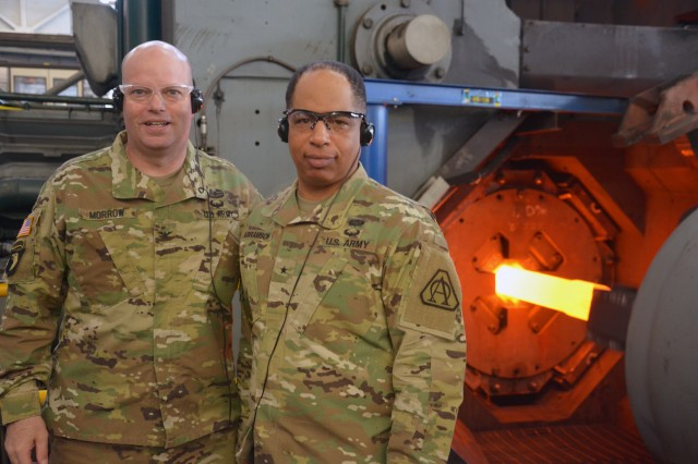 Arsenal Commander Col. Joseph Morrow, left, standing with Brig. Gen. Alfred Abramson as a 120mm barrel is being forged.