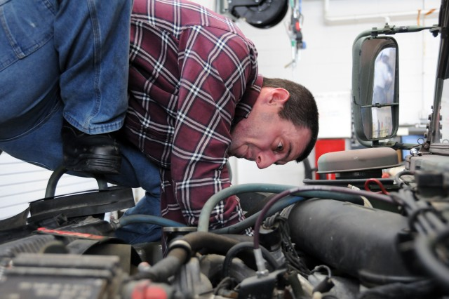 Paul Bettit, a heavy mobile equipment repairman at the U.S. Army Reserve's equipment concentration site 27 at Joint Base McGuire-Dix-Lakehurst, New Jersey, works on a High Mobility Multipurpose Wheeled Vehicle. Mechanics at ECS 27 are busy preparing vehicles and equipment for the 78th Training Division's Warrior Exercise.