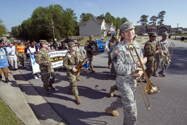 The 282nd Army Band and school-aged children march up Imboden Street during the Child Abuse Prevention walk April 14. Maj. Gen. Pete Johnson, Fort Jackson commander also joined in the walk.