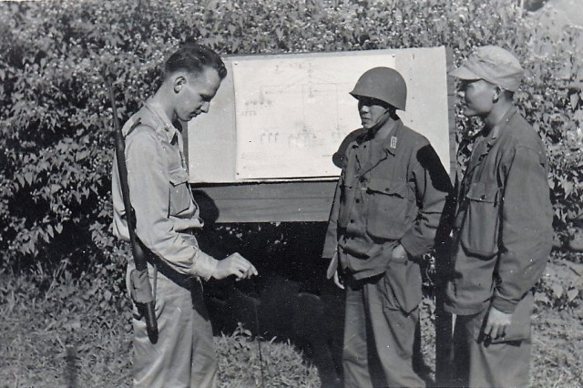 Maj. Gen. Milton Pilcher in a communications briefing with the Chinese during World War II.