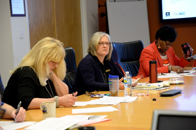 Kelly Zayak, Business Management Chief; Joyce Hampshire, Chief of the Operations Support Division; Sonya Gadson, Operations Officer, listen intently during the morning session. Gadson was instrumental in bringing the pilot session to PEO C3T.