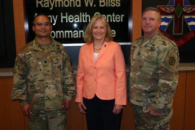 Raymond W. Bliss Army Health Center Commander, Lt. Col. Edgar G. Arroyo (left) and RWBAHC Command Sgt. Maj. Arnold Hill (right) with Ms. Hollyanne Milley.
