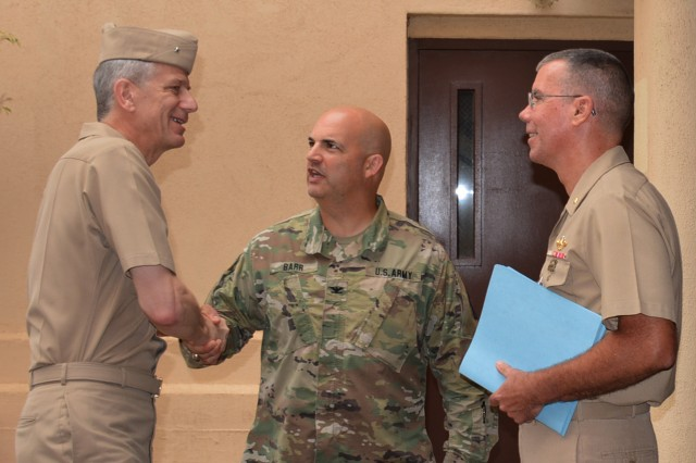Col. Andrew M. Barr (center), Tripler commander, and Navy Capt. Jeffrey W. Timby (right), Tripler deputy commanding officer, both greet Rear Adm. Paul D. Pearigen (left), commander of Navy Medicine West, upon his arrival to tour Tripler Army Medical Center.