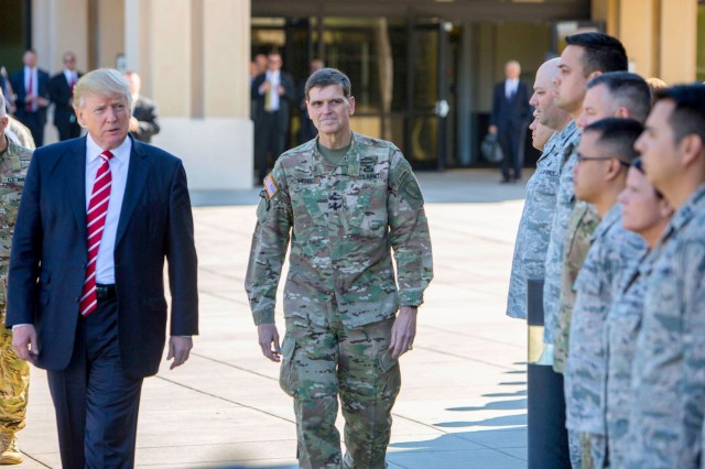 President Donald J. Trump and U.S. Army Gen. Joseph L. Votel, Commander, U.S. Central Command spend a few minutes with troops on their way to today's press briefing. President Trump visited USCENTCOM headquarters to discuss issues relevant to the CENTCOM Area of Responsibility.