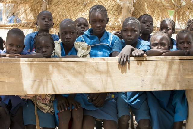 Students share a desk while attending a school in northern Cameroon, which an Army civil affairs team visited along with other schools to see how they can help improve them April 20, 2017. The team, part of the 101st Airborne Division-led Task Force Toccoa and U.S. Army Africa's efforts of helping African nations defeat Boko Haram, spoke to local school officials on issues the schools are facing, so they can plan possible school projects in the future.