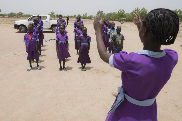 Rows of students welcome an Army civil affairs team with a song before they tour their primary school in northern Cameroon April 20, 2017. The team, part of the 101st Airborne Division-led Task Force Toccoa and U.S. Army Africa's efforts of helping African nations defeat Boko Haram, spoke to local officials on issues the schools are facing, so they can plan possible school projects in the future.
