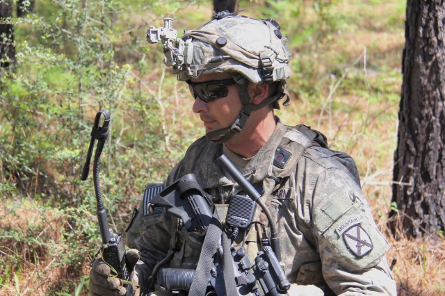 A Soldier from the 1st Brigade Combat Team (BCT), 10th Mountain Division (Light Infantry) patrols with a Rifleman Radio during the BCT's Joint Readiness Training Center rotation at Fort Polk, Louisiana, March 25, 2017.
