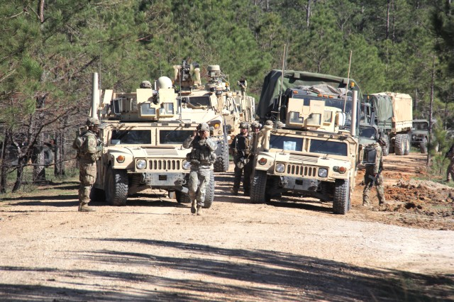 Soldiers from the 1st Brigade Combat Team (BCT), 10th Mountain Division (Light Infantry) patrol with a convoy of Warfighter Information Network-Tactical Increment 2 vehicles during the BCT's Joint Readiness Training Center rotation at Fort Polk, Louisiana, March 25, 2017.