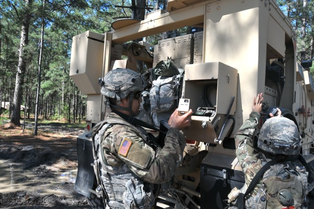 Soldiers from the 1st Brigade Combat Team (BCT), 10th Mountain Division (Light Infantry) inspect a Mine-Resistant Ambush-Protected All-Terrain Vehicle (M-ATV) with a Soldier Network Extension during the BCT's Joint Readiness Training Center rotation at Fort Polk, Louisiana, March 18, 2017.
