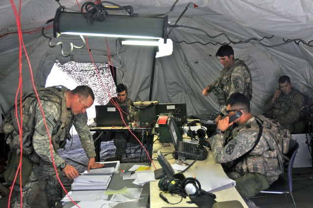 Soldiers from the 1st Brigade Combat Team (BCT), 10th Mountain Division (Light Infantry) plan for missions inside a tactical operations center during the BCT's Joint Readiness Training Center rotation at Fort Polk, Louisiana, March 25, 2017.