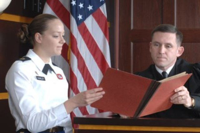 In 2012, Staff Sgt. Sarah Hawley, a paralegal noncommissioned officer with the U.S. Army Reserve Legal Command worked at the court at Fort Bragg, NC. She is pictured here with a military judge is Lt. Col. Bret Batdorff.