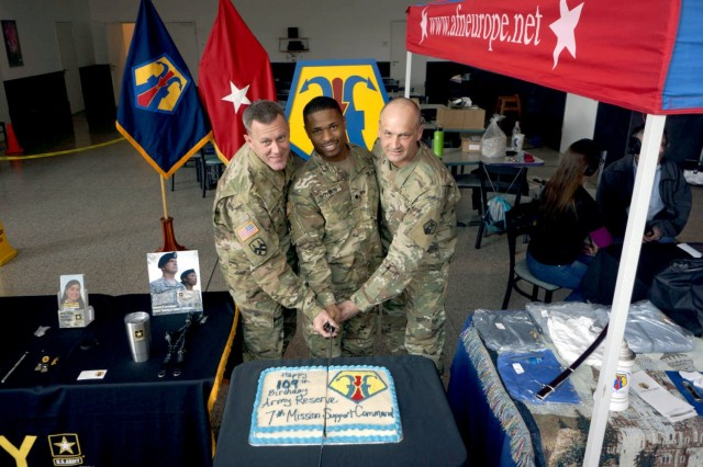 KAISERSLAUTERN, Germany - Brig. Gen. Steven Ainsworth, left, Command Sgt. Maj. Raymond Brown, right, and Spc. Jonathan Boyden, center, pose after cutting the Army Reserve birthday cake Friday, April 21 at the Kaiserslautern Military Community Center on Ramstein Air Base. The afternoon event was organized by the 7th Mission Support Command to celebrate the 109th Army Reserve birthday.