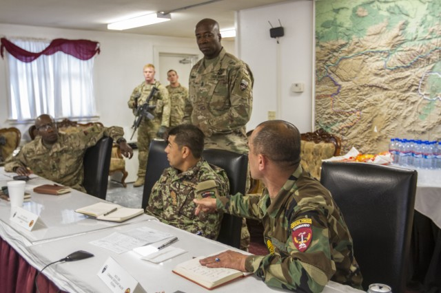 Afghan National Army command Sgt. Maj. Safi Roshan discuss emerging practices in developing and using the NCO corps to help overcome other challenges facing the ANA with senior leaders across Afghanistan.