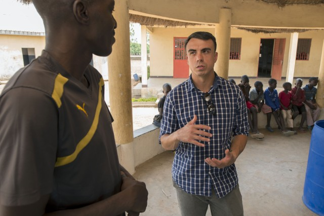 Sgt. 1st Class Sean Acosta, the NCO in charge of the 83rd Civil Affairs Battalion's Team 8321, discusses the issues facing the Sarre Jabaamma youth rehabilitation center with its director in Garoua, Cameroon, April 22, 2017.