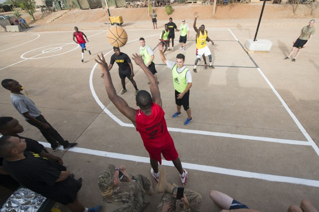 Col. Nicholas Ngepi, the local gendarmerie unit's chief of staff, passes in the ball during a basketball game with American and Cameroonian military members in Garoua, Cameroon, April 21, 2017. Task Force Toccoa, which is supporting Cameroon's efforts against Boko Haram, decided to hold the game for the first time to help build better cohesion between both militaries.