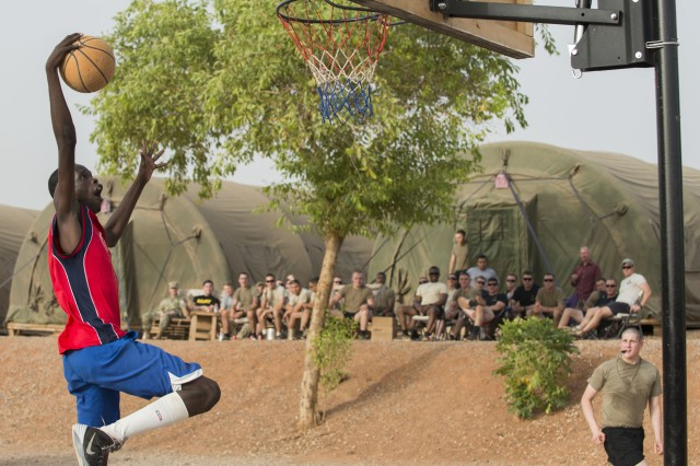 Alexis, a soldier with Cameroon's gendarmerie force, soars in for a slam dunk during a basketball game with American and Cameroonian military members in Garoua, Cameroon, April 21, 2017.