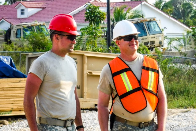 Sgt. Jason Klimesh and Spc. Patrick Ray of the 672nd Engineer Company, 301st Maneuver Enhancement Brigade, look over the Ladyville job site for safety compliance in Ladyville, Belize. The soldiers were deployed to Belize in support of Beyond the Horizon, U.S. Army South and U.S. Southern Command's annual multinational humanitarian and civic assistance program (Courtesy Photo).