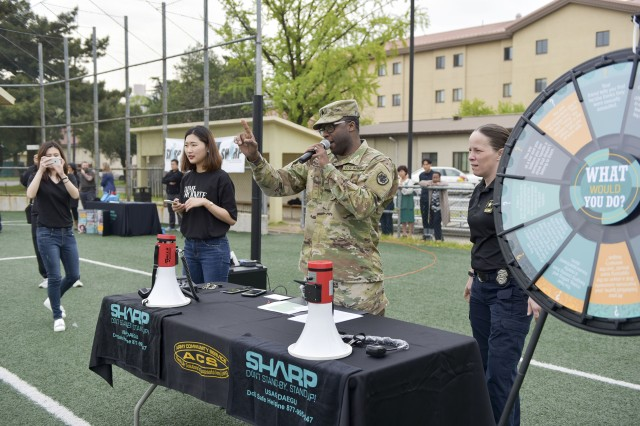 Sgt. Humphreys from American Forces Network Daegu asks questions about SHARP to Soldiers during the SHARP Olympics on Apr. 20.