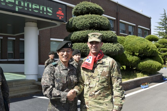 Col. Ted Stephens shakes hands with Korea Army Academy at Yeoncheon superintendent Maj. Gen. Seo, Jung-yeol before his lecture to KAAY Cadets on Apr. 19.