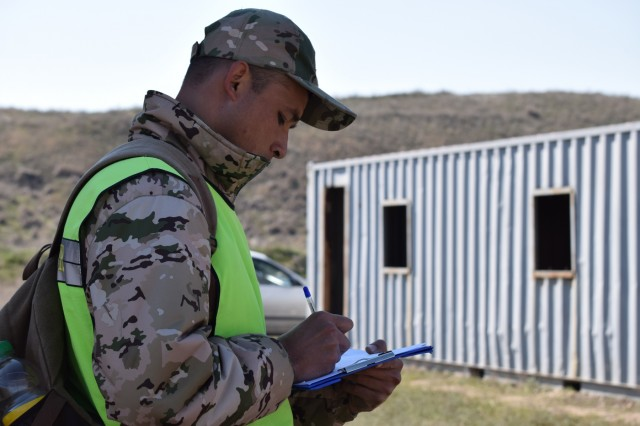 A Kazakhstani instructor takes observation notes during a peacekeeping operation scenario for Steppe Eagle Koktem Apr. 10, 2017, at Illisky Training Center, Kazakhstan.