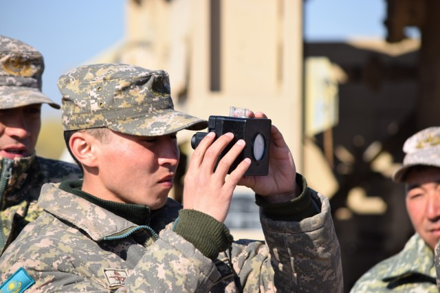 A soldier with the Kazakhstan Peacekeeping Battalion tests the PH level of the purified water during a peacekeeping operations scenario for Steppe Eagle Koktem Apr. 9, 2017, at Illisky Training Center, Kazakhstan. Water purification is essential to supporting local and displaced personnel during actual peacekeeping operations.