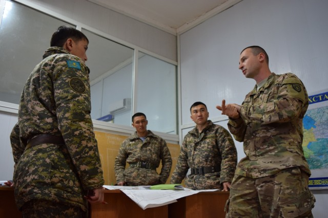 Capt. Denis Babiyev, 149th Military Engagement Team, Kentucky National Guard, discusses fire support operations with Kazakhstani soldiers during Steppe Eagle Koktem Apr. 2, 2017, at Illisky Training Center, Kazakhstan. Fire Support is one of many military-to-military engagements that take place simultaneously during Koktem, the first phase of Exercise Steppe Eagle.
