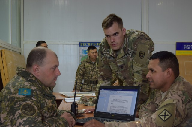 Two U.S. Army Soldiers and a Kazakhstani Soldier with the Kazakhstan Peacekeeping Battalion Sustainment Company develop a company operations order Apr. 2, 2017, that will be used for the rest of Exercise Steppe Eagle. Exercise Steppe Eagle 17 takes place in Kazakhstan beginning July 22, 2017, and focuses on multinational Peacekeeping and Peace Support Operations.