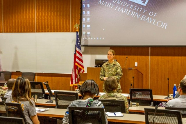 Col. Laura Knapp, commander of the Fort Hood-based 504th Military Intelligence Brigade, addresses the audience at the 1st Annual Women's Leadership Symposium held at the University of Mary Hardin-Baylor, March 28. Nearly 30 ROTC cadets and students attended the symposium.
